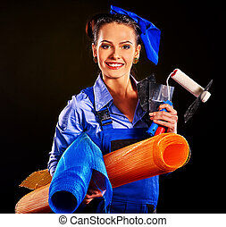 Woman builder with construction tools.