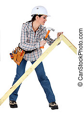 Woman building a frame