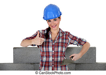 Woman building wall