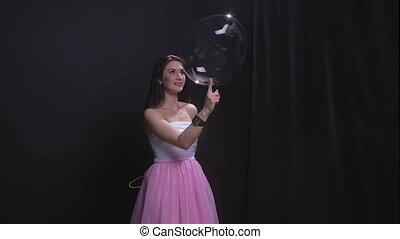 Woman bursting big soap bubble - Woman with soap bubbles,...