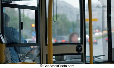 Woman bus driver at work - Bus making a stop on red signal...