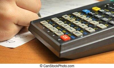 Woman Businessman using a calculator hands doing an account.