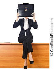 Woman businesswoman sitting on the desk