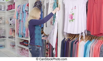 clothing department store - Woman buyer looking for clothes...