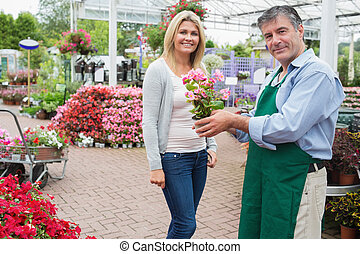 Woman buying a plant
