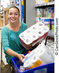 Woman buying bath tissue in the shopping mallin the shopping mall