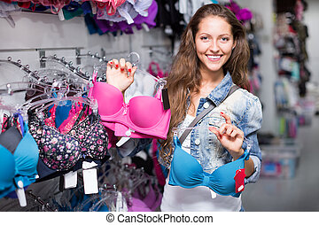 Woman buying brassiere
