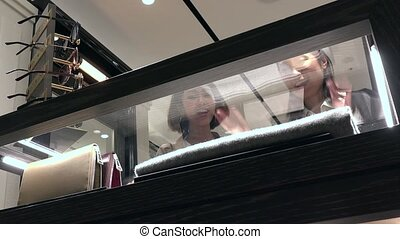 Woman Buying Fashion Accessories In Shopping Mall With Sales...