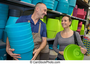 woman buying flower pot in the store