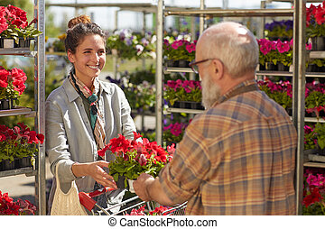 Woman Buying Flowers at Plantation