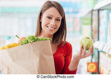 Woman buying fresh vegetables