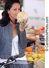 Woman buying fruit at market