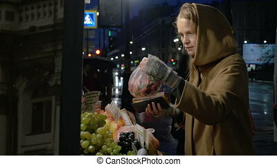 Woman buying fruit in outdoor market