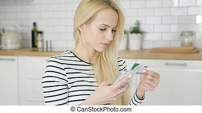 Woman buying in Internet through phone