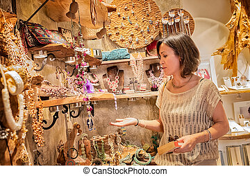 Woman buying jewelry in a store