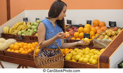 Woman Buying Lemons at the Market
