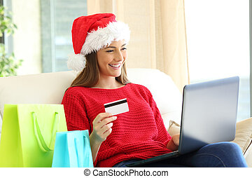 Woman buying on line christmas gifts