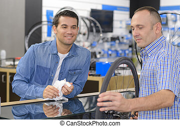 woman buying parts in bike shop