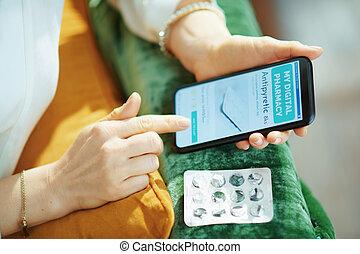 woman buying pharma using phone