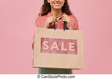 Woman buying purchases on sale