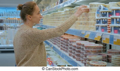 Woman buying sea food at supermarket - Woman buying sea food...