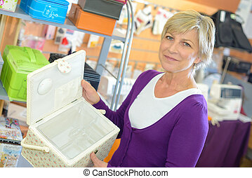 woman buying sewing box in a shop