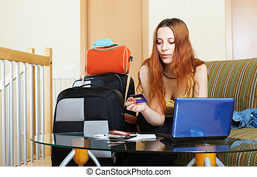 Woman buying tickets or reserving hotel online