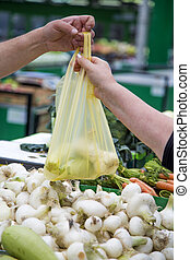 Woman buying vegetables on the market