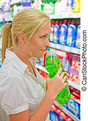 woman buys cleaning products in a supermarket