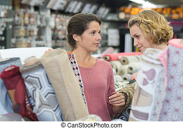 woman buys fabric in a store