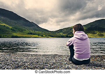 Woman by Crummock Water, Lake District.
