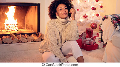 Woman by fireplace and white christmas tree