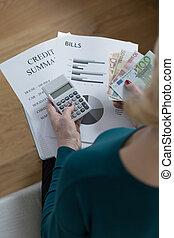 Woman calculating bills