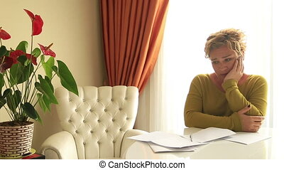 Woman Calculating Budget At Home