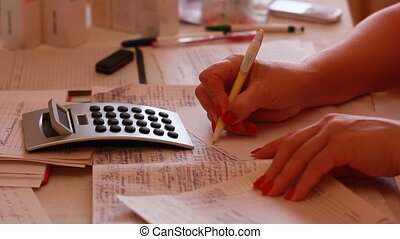 woman calculating home finances