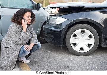 Woman calling emergency help after car crash