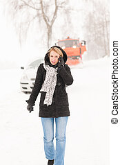 Woman calling for help broken car snow