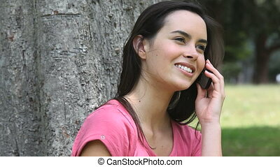 Woman calling in a park