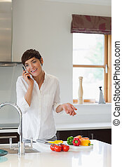 Woman calling in her kitchen