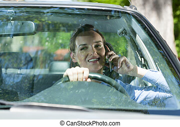 Woman calling mobile phone during driving a car