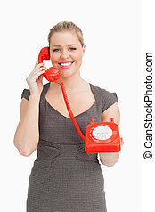 Woman calling with a dial phone