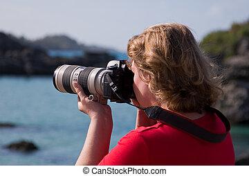 Woman, Camera, Large white lens.