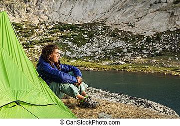 Woman Camper Watching Sunset