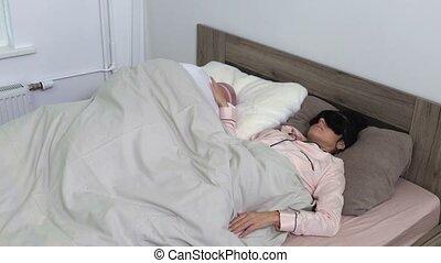 Woman can't sleep because man snoring