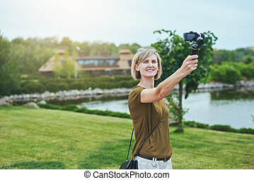 Woman capturing herself with personal camera