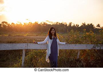 woman carefree and enjoy sunset