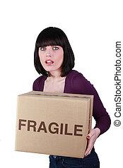 Woman carefully holding fragile box