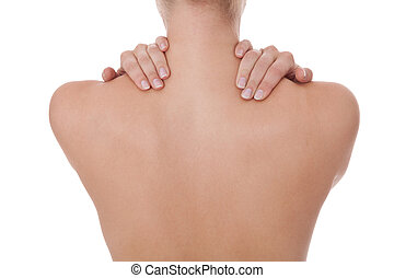 Woman caressing her bare shoulder and back - Woman standing...