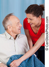 Woman caring about disabled man
