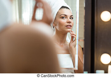 Woman caring about her skin
